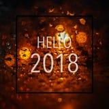 Abstrakter bokeh Lichthintergrund mit Text hallo 2018 Lizenzfreies Stockbild