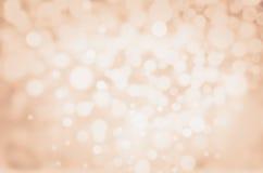 Abstrakter Defocused Gold-Bokeh-Licht Weinlesehintergrund. Elegant Lizenzfreie Stockfotos
