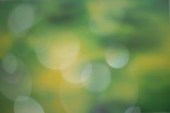 Abstrakter dunkelgrüner bokeh Hintergrund Stockbild