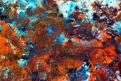Abstrakter dunkelorangefarbiger blauer Farbenhintergrund, malender Aquarellhintergrund, malende abstrakte Farben stockbild