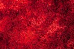 Abstrakter dunkelorangefarbiger Teppich auf dem Boden Lizenzfreie Stockfotografie