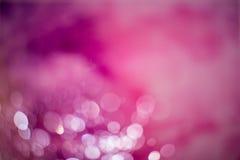 Abstrakter dunkler purpurroter bokeh Hintergrund Stockfotos