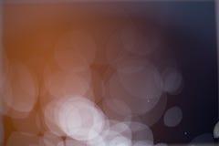 Abstrakter dunkler und hellbrauner bokeh Hintergrund Stockbild