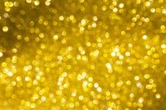 Abstrakter festlicher Konzepthintergrund des glänzenden Gold-bokeh Stockfotos