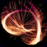 Abstrakter Fractal-spinnende Beleuchtung mit den roten und orange Linien stockfotos