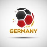 Abstrakter Fußball mit deutschen Staatsflaggefarben Stockfoto