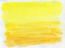 Abstrakter gelber Aquarellhintergrund Stockbild