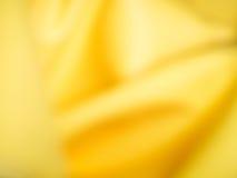 Abstrakter gelber Steigungs- und Bewegungsunschärfehintergrund Lizenzfreies Stockfoto