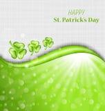 Abstrakter glühender Hintergrund mit grünem Klee für St Patrick Stockfotografie
