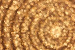 Abstrakter goldener bokeh Hintergrund Lizenzfreie Stockfotos