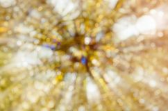 Abstrakter goldener bokeh Hintergrund in der Bewegung stockfotografie