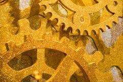 Abstrakter goldener glänzender Uhrwerkhintergrund Lizenzfreie Stockfotografie