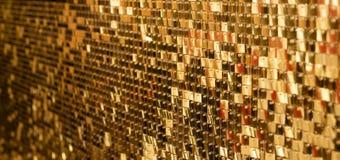 Abstrakter goldener Hintergrund von funkelnden Weihnachtslichtern lizenzfreie stockbilder