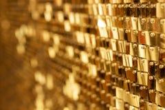Abstrakter goldener Hintergrund von funkelnden Weihnachtslichtern lizenzfreies stockfoto