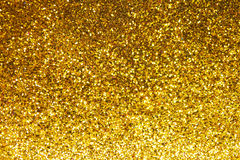 Abstrakter Goldfunkelnhintergrund Lizenzfreies Stockfoto