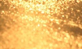 Abstrakter Goldhintergrund Stockfotografie