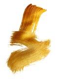 Abstrakter Goldhintergrund mit Acrylpinsel auf weißem Hintergrund Stockfotos