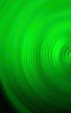 Abstrakter grüner Hintergrund der bunten Drehbeschleunigungsradialstrahlbewegungsunschärfe Lizenzfreie Stockfotografie