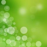 Abstrakter grüner Hintergrund mit hellen Kreisen Lizenzfreie Stockfotografie