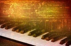 Abstrakter Grungehintergrund mit Klavierschlüsseln Stockfotos