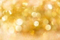 Abstrakter Hintergrund bokeh des strahlenden Golds Lizenzfreie Stockfotos