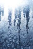 Abstrakter Hintergrund der blauen Schneeflocken Stockfoto