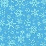 Abstrakter Hintergrund der blauen Weihnachtsschneeflocken Stockfotografie