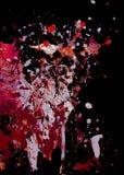 Abstrakter Hintergrund der bunten Farbe spritzt auf Schwarzes Stockfotografie