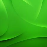 Abstrakter Hintergrund der grünen Wellen Stockfotos