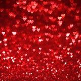 Abstrakter Hintergrund der hellen roten Herzen Lizenzfreies Stockfoto