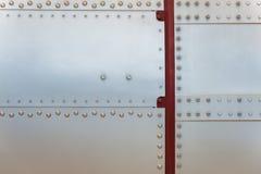 Abstrakter Hintergrund des Metalls und der Niete Lizenzfreie Stockfotos