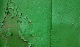 Abstrakter Hintergrund einer Metallwand einer grünen Kräuterfarbe mit Beschaffenheit einer alten fallenden Farbe Stockfotos
