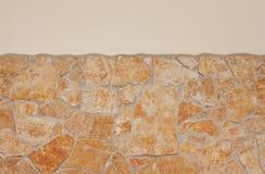 Abstrakter Hintergrund einer rustikalen kieselsteinfreien Wand stockbild