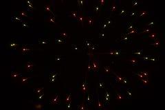 Abstrakter Hintergrund: Feuerwerks-Streuung in den Weihnachtsfarben Stockfotos