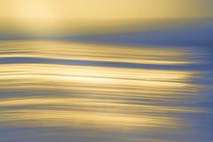 Abstrakter Hintergrund in Gelbem und in Blauem, Meereswogen stockbilder