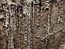 Abstrakter Hintergrund heftige Textilfranse im Sepia Stockbild