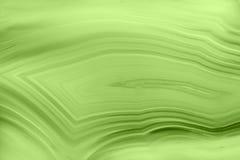 Abstrakter Hintergrund - Mineralgrün des makro PANTONE der grünen Achatscheibe Lizenzfreies Stockfoto