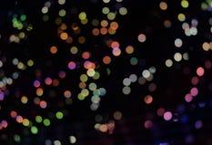 Abstrakter Hintergrund mit bokeh Lichtern und Sternen Lizenzfreies Stockbild