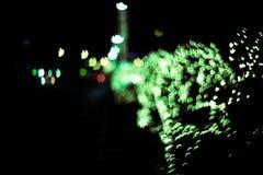 Abstrakter Hintergrund mit bokeh Lichtern und Sternen Lizenzfreies Stockfoto