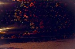 Abstrakter Hintergrund mit leuchtenden mehrfarbigen Sternen Lizenzfreies Stockbild