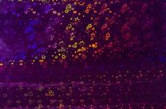 Abstrakter Hintergrund mit leuchtenden mehrfarbigen Sternen Lizenzfreie Stockfotos