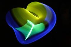 Abstrakter Hintergrund mit Lichtern in unscharfer Bewegung in der Nacht oder in den Feuerwerken an Sylvesterabend Stockbild
