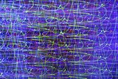 Abstrakter Hintergrund mit Neonlichtern in der Bewegung Stockbild