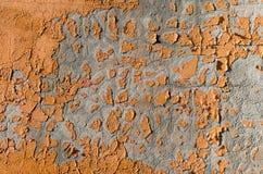 Abstrakter Hintergrund mit orange Farben-Abfällen auf einer Wand Lizenzfreie Stockbilder