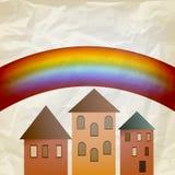 Abstrakter Hintergrund mit Regenbogen und Häusern Lizenzfreie Stockbilder