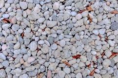 Abstrakter Hintergrund mit runden peeble Steinen Stockfotos