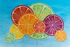 Abstrakter Hintergrund mit Zitrusfruchtscheiben Bildzitrusfruchtbälle lizenzfreies stockfoto