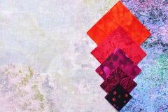 Abstrakter Hintergrund von den Stücken steppenden Geweben Lizenzfreies Stockfoto