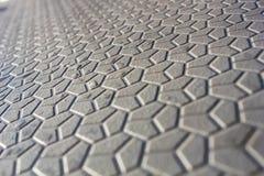 Abstrakter Hintergrund von geometrischen Formen, Formen auf der Pflasterung, ein futuristischer Hintergrund von Hexagonen stockfotos