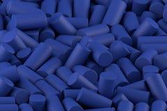 Abstrakter Hintergrund von nach dem Zufall vereinbarten Mattzylindern des Blaus lizenzfreie stockfotografie